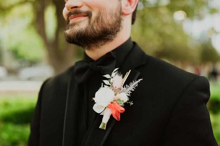 Modern Groom with Black Tuxedo Jacket, Black Bow Tie and Contrasting Boutonniere