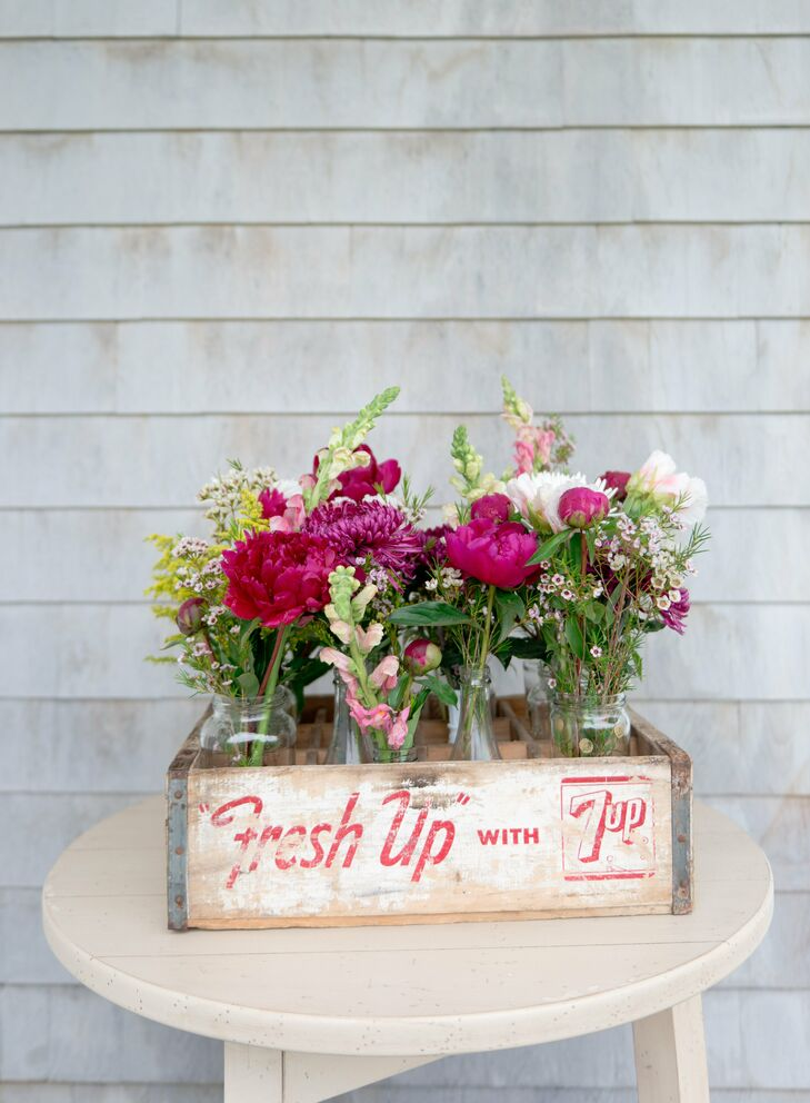 Laura and Lee incorporated vintage props into the decor, such as a wood soda crate used in place of a more traditional flower vase.