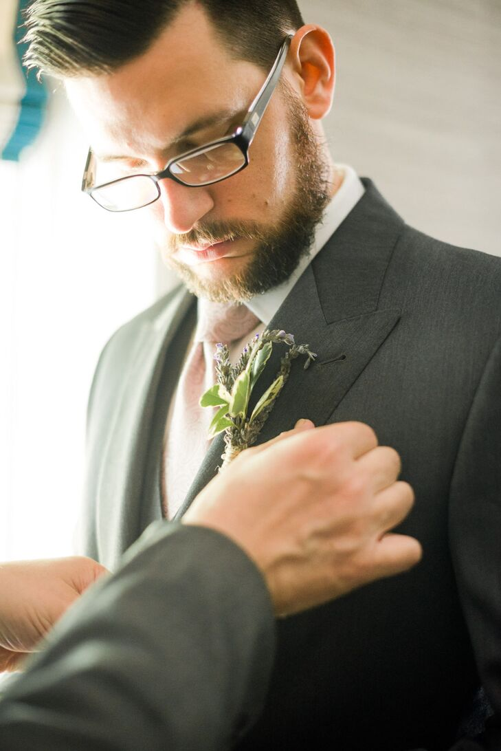 For the June wedding, the men opted not to wear tuxedos. Garrett wore a custom-made suit, choosing every detail, from the stitching to the buttons, in a dark gray.