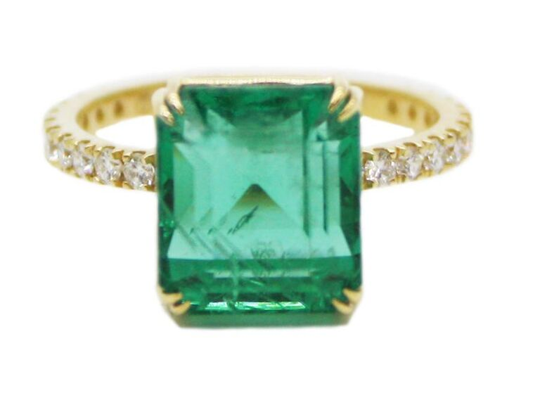 Emerald and diamond engagement ring with pavé band