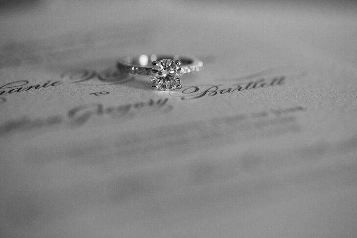 Stephanie's wedding ring is a gorgeous round stone with a pave diamond band from Henne Jewelers in Pittsburgh.