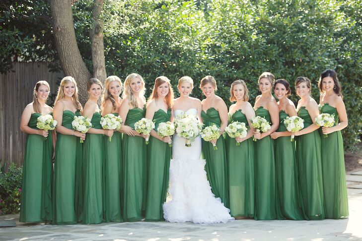 With a green and white palette for the whole wedding, Lucy chose floor-length green dresses for her bridesmaids. Each carried a green and white bouquet of roses, lisianthus, hydrangeas, coxcomb and succulents.