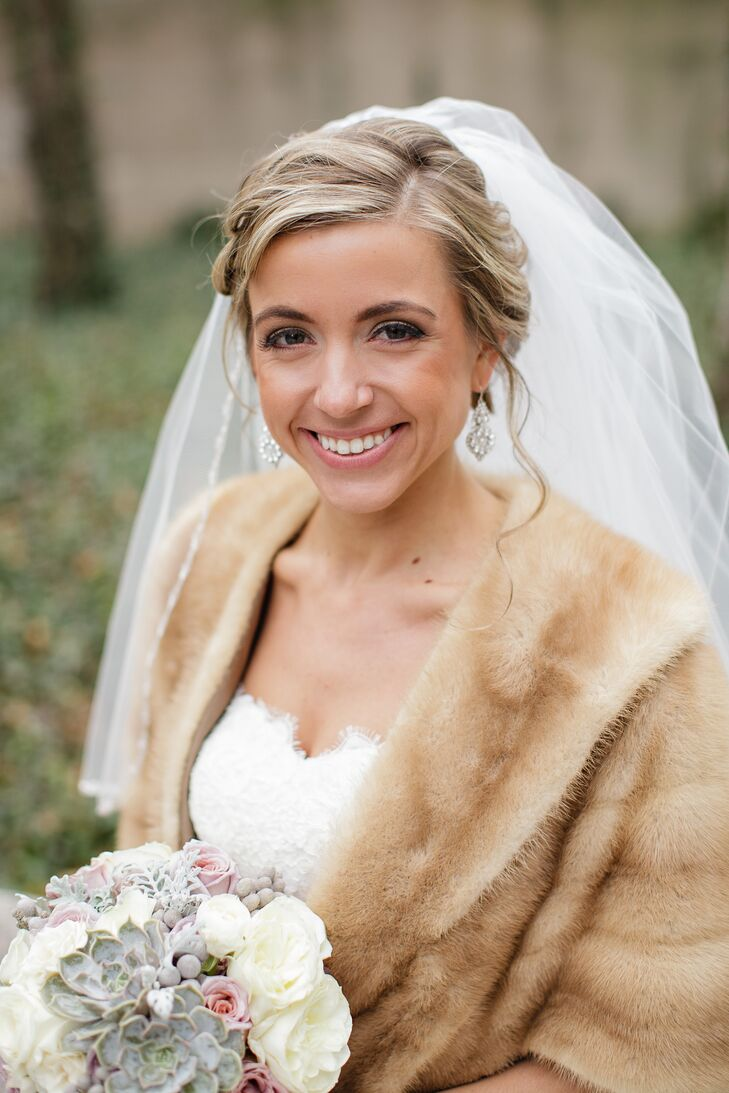 "The bride wore drop earrings and a swept-back hairstyle complete with soft waves. ""It was a wind-blown look that's not hard to get in the Windy City!"" Amanda laughs."
