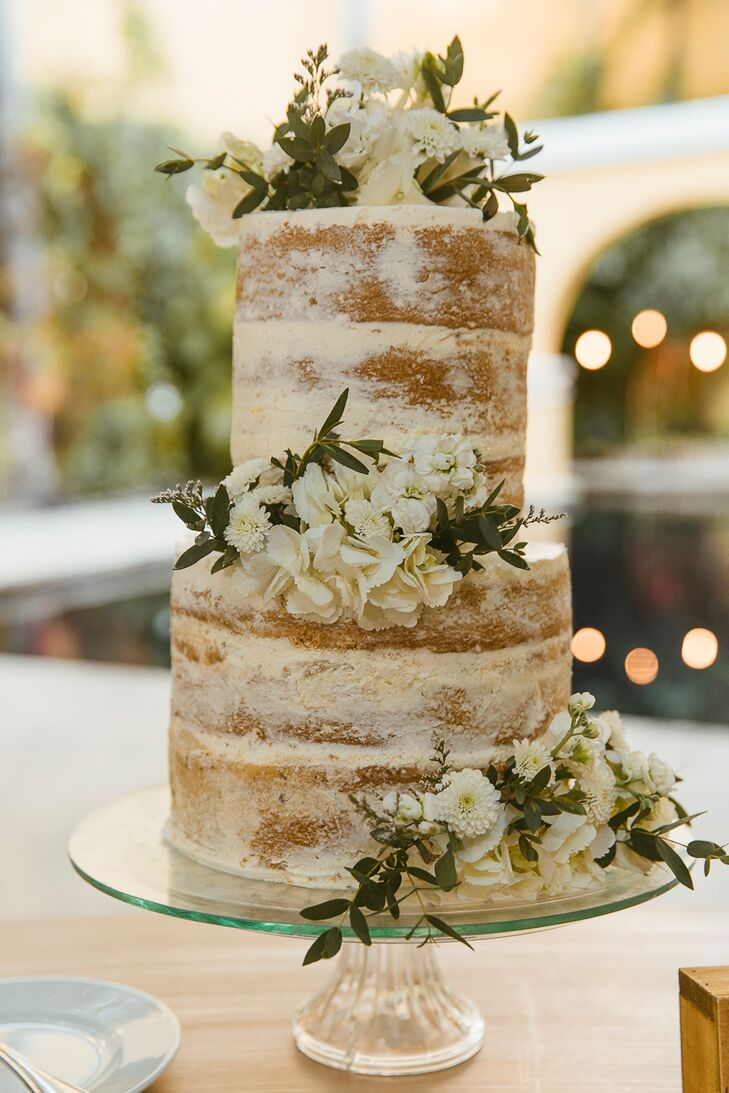 Naked Wedding Cake with White Flowers and Greenery
