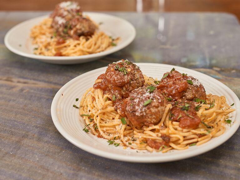 Two plates of spaghetti with meatballs al forno