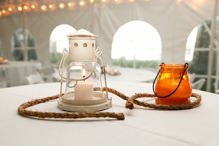 The tented reception included various plays on the bride and groom's nautical theme including antique lanterns and rope detailing.
