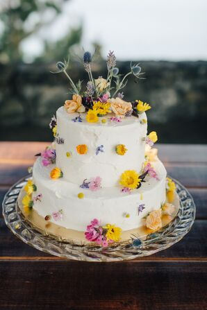 Tiered Cake Covered with Yellow Wildflowers