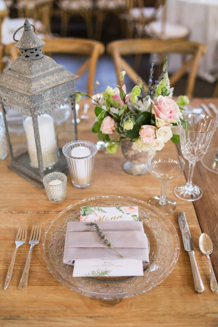 For a relaxed touch, each wooden table at the reception was set with a variety of crystal plates, which were flanked by silver flatware and white votive candles.
