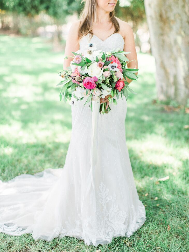 Katlyn worked with Holland-based florist, Spring Sweet, to design a lush bouquet of greenery, peonies and white anemones—the bride's favorite.