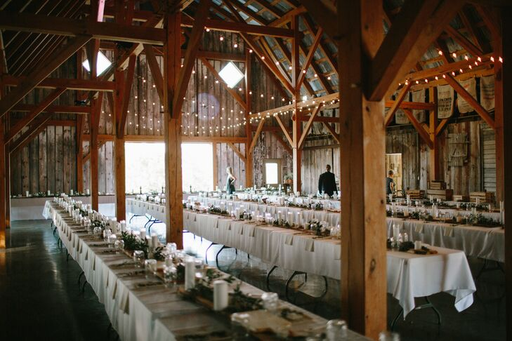 Barn Reception with String Lights and Long Dining Tables