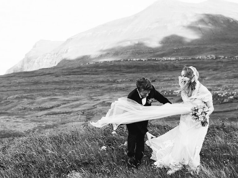 bride and groom caught in the wind