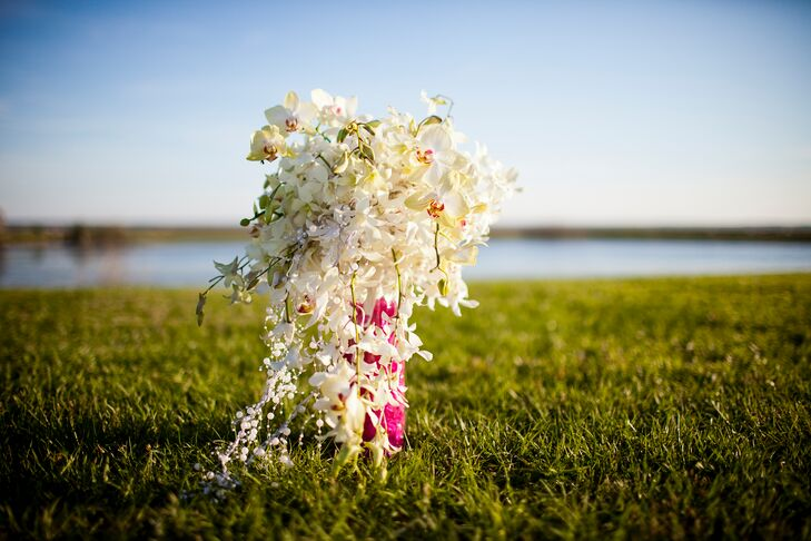 Sandra's favorite flower is the orchid, so the boutonnieres, bridesmaid and bridal bouquets all featured orchids. The bridal bouquet was a flowing arrangement of white dendrobium orchids with pearls.
