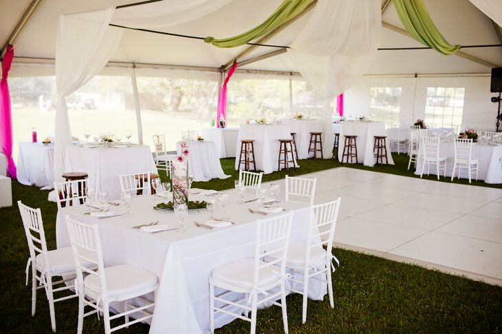 To celebrate the summer season, the couple chose a bright color palette of watermelon pink and perky peach. The colors popped agains the white furniture and table linens at the reception and complemented the Whalehead Club's own vibrant colors.