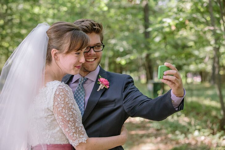 The couple took a moment to capture a selfie in the woods.