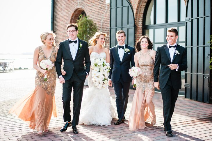 """Hayley's sister and cousin stood by her side as she exchanged vows with Jared. To complement the ornate, glamorous feel of Hayley's gown, the girls donned floor-length gowns from Eleanor Schain in a soft nude hue, each adorned with hand-painted metallic details. """"The dress store was able to contact the designer and request two custom gowns made in the same material with similar paintings, but different styles, so that each bridesmaid had a unique gown,"""" says Hayley."""