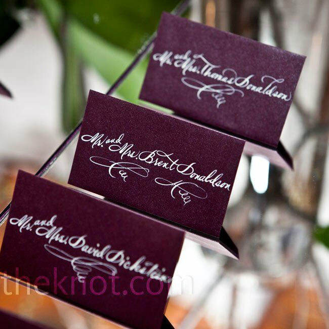 Classic white calligraphy popped against the plum-colored escort cards.