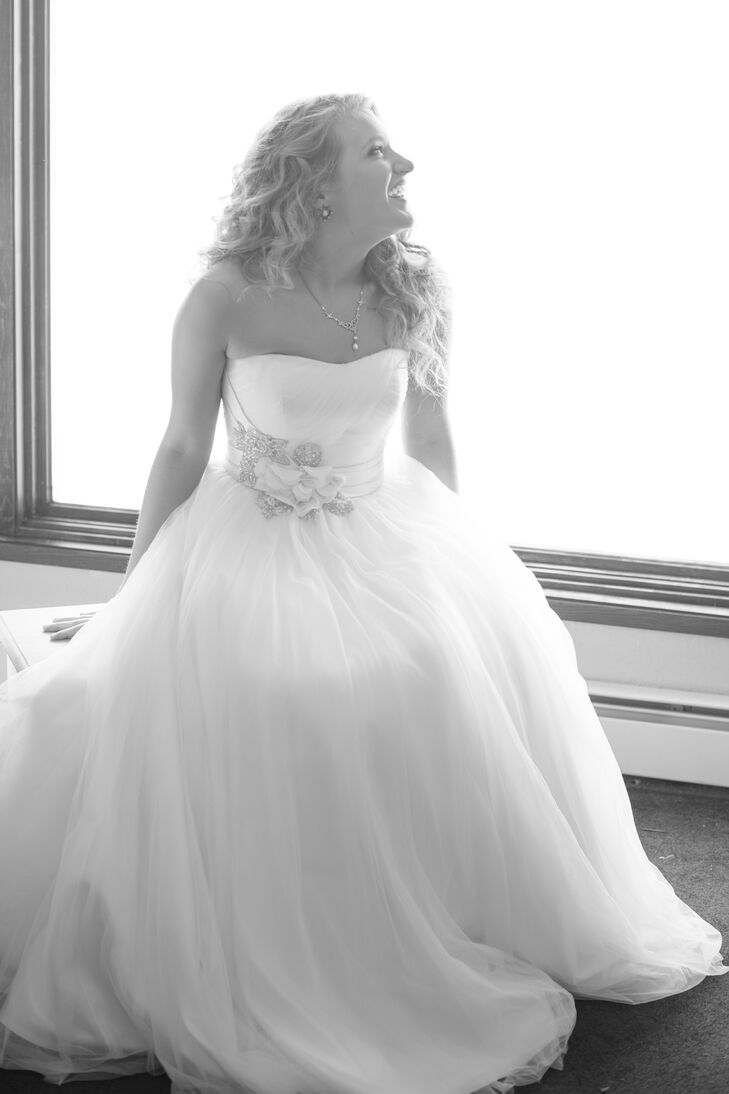 Bradi wore a strapless Oleg Cassini tulle ball gown from David's Bridal. It was decorated with a crystals and rose at the waist for just enough sparkle.