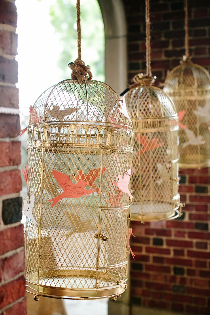 The place cards—paper cut-outs of birds—were displayed on vintage-inspired golden bird cages.