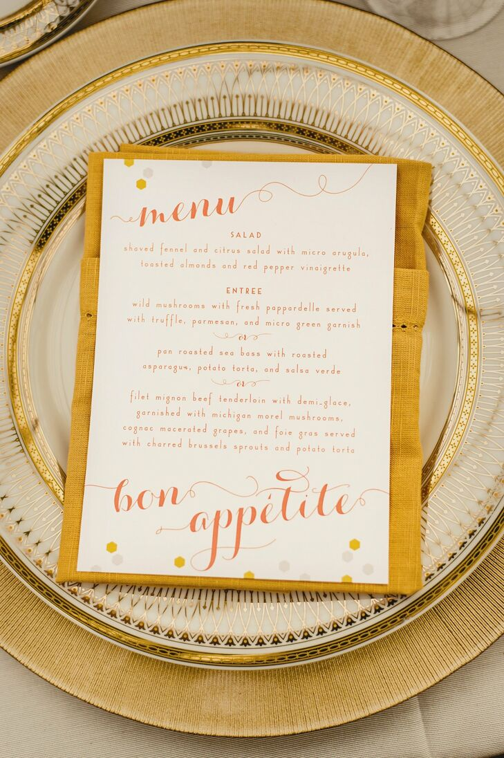 Keeping with the Art Deco theme, Carly and David chose gold accented china with a 1930's style pattern, which they paired with gold-toned linens. The menu cards were designed in the same style as the escort cards with modern honeycomb motifs and coral Art Deco and script fonts.