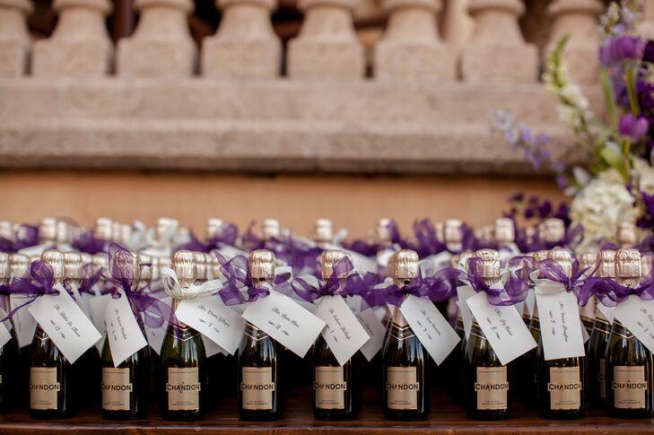 Miniature Champagne Bottle Favors With Purple Ribbon