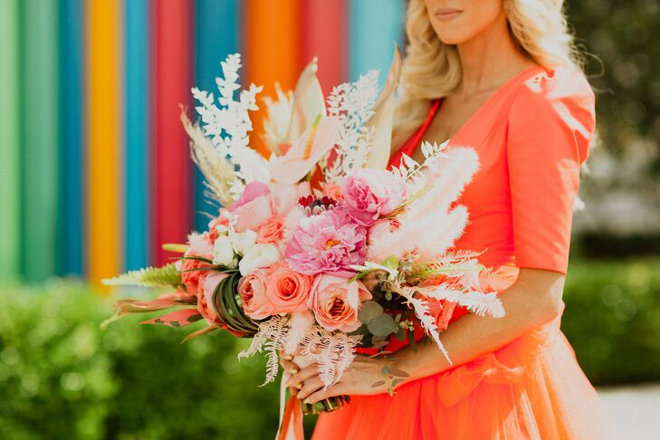 Modern Red Wedding Dress and Pink Bouquet of Peonies, Roses and Dyed Grasses