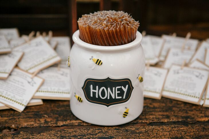Amanda and Bo gave honey sticks to their guests as favors. They also gave them bee cutouts, which were imprinted with flower seeds. Once planted these seeds provide a source of pollen for honey bee populations.