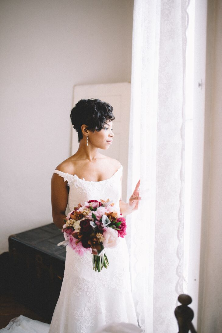 "In keeping with the vintage theme, Morgan decided on a classic beauty look for her walk down the aisle. She opted for an elegant curled hairstyle, with finger waves on the sides and tight curls on top. ""With the makeup, I wanted to look as natural as possible, with pinks and berries as my palette,"" Morgan says. ""On my eyes we did a smoky gold look. And for my lips we did a pink-nude for the ceremony and a showstopping berry color for the reception ."""