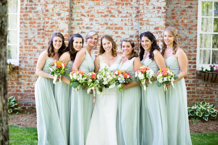 Anna's bridesmaids wore floor-length, sage green chiffon dresses, 2 different styles.