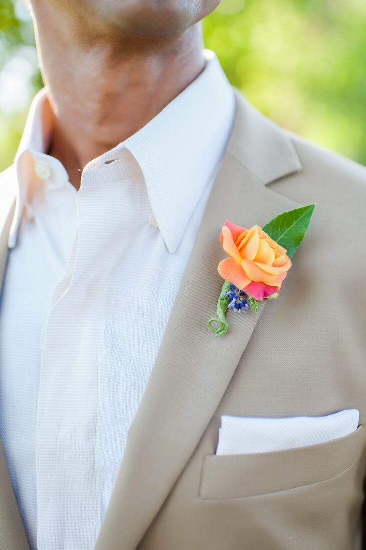 An ombre rose and bright blue accent flower created the illusion of a rainbow on James' lapel.