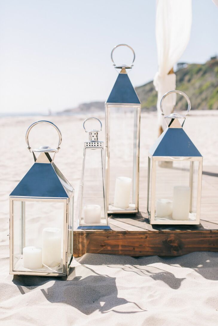 Oversize silver lanterns filled with candles provided romantic lighting later in the evening.