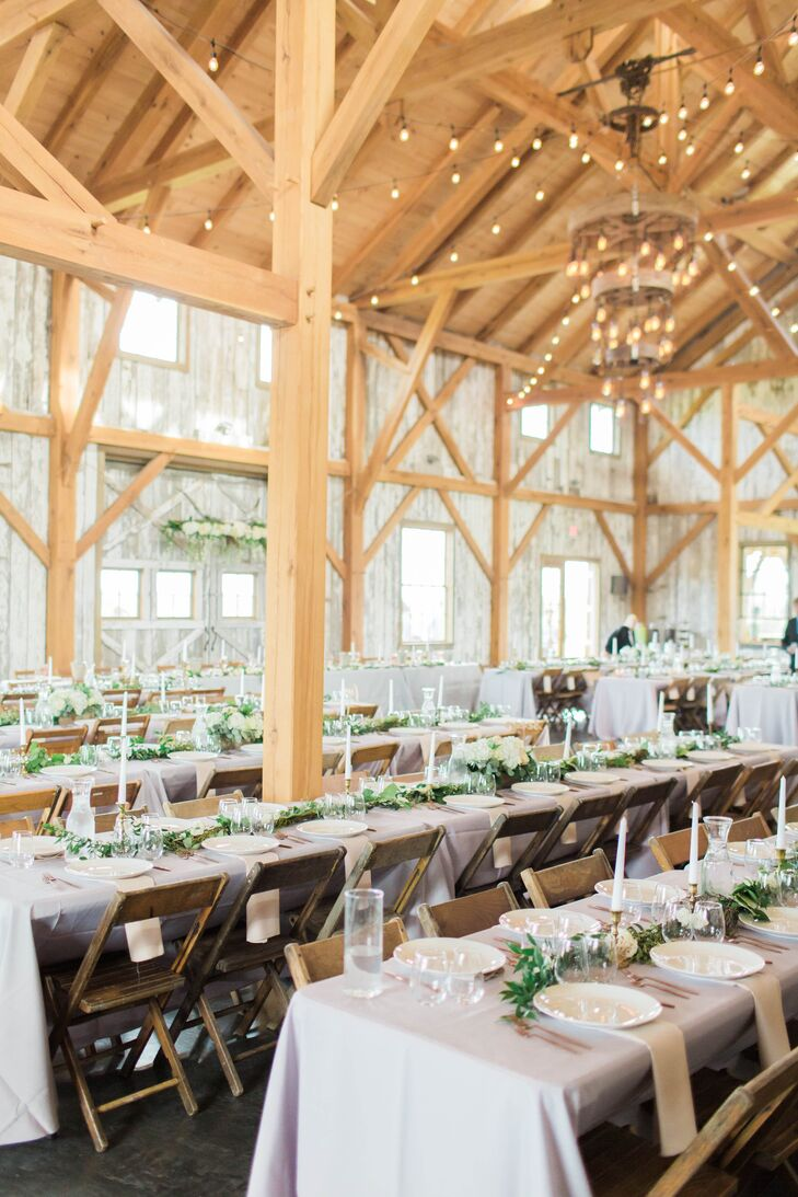 Rustic Barn Reception with Wooden Chairs and String Lights
