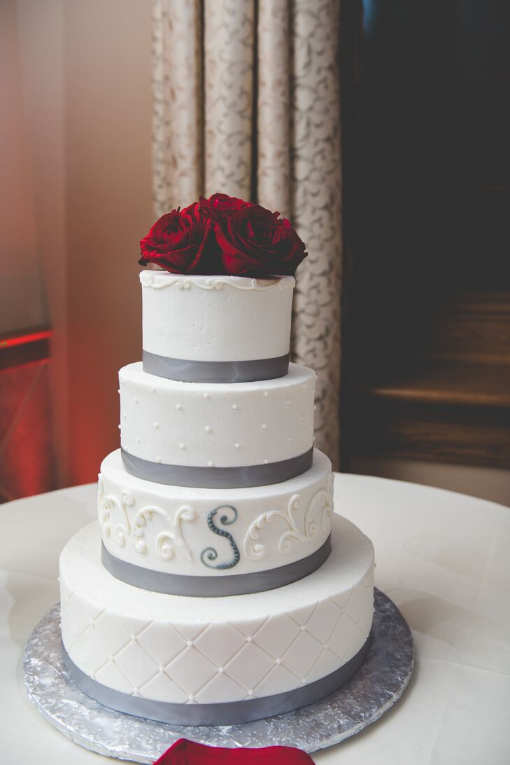 White Wedding Cake With Silver Ribbon And Red Roses