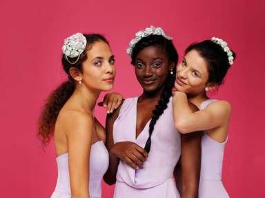 three bridesmaids in purple dresses
