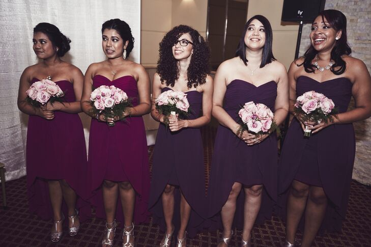 The bridesmaids wore strapless cocktail dresses in varying shades of purple.