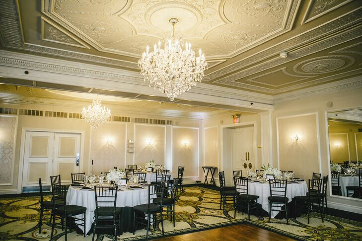 The reception was held in the elegant ballroom at the Molly Pritcher Inn. The couple kept the decor simple, yet sophisticated, choosing arrangements of white hydrangeas and stock placed in low black square vases (allowing guests to easy see and talk to one another)as well as black and white table linens to tie into their theme.