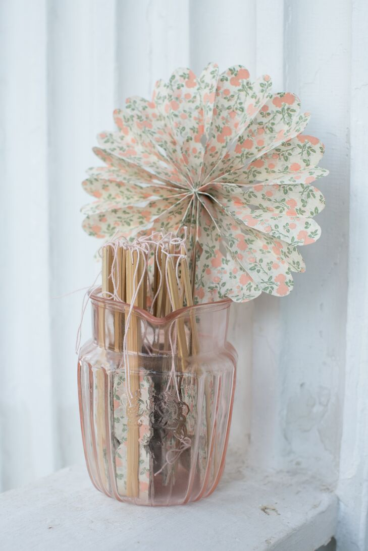 Kate loved her antique-looking paper fans for her outdoor wedding.
