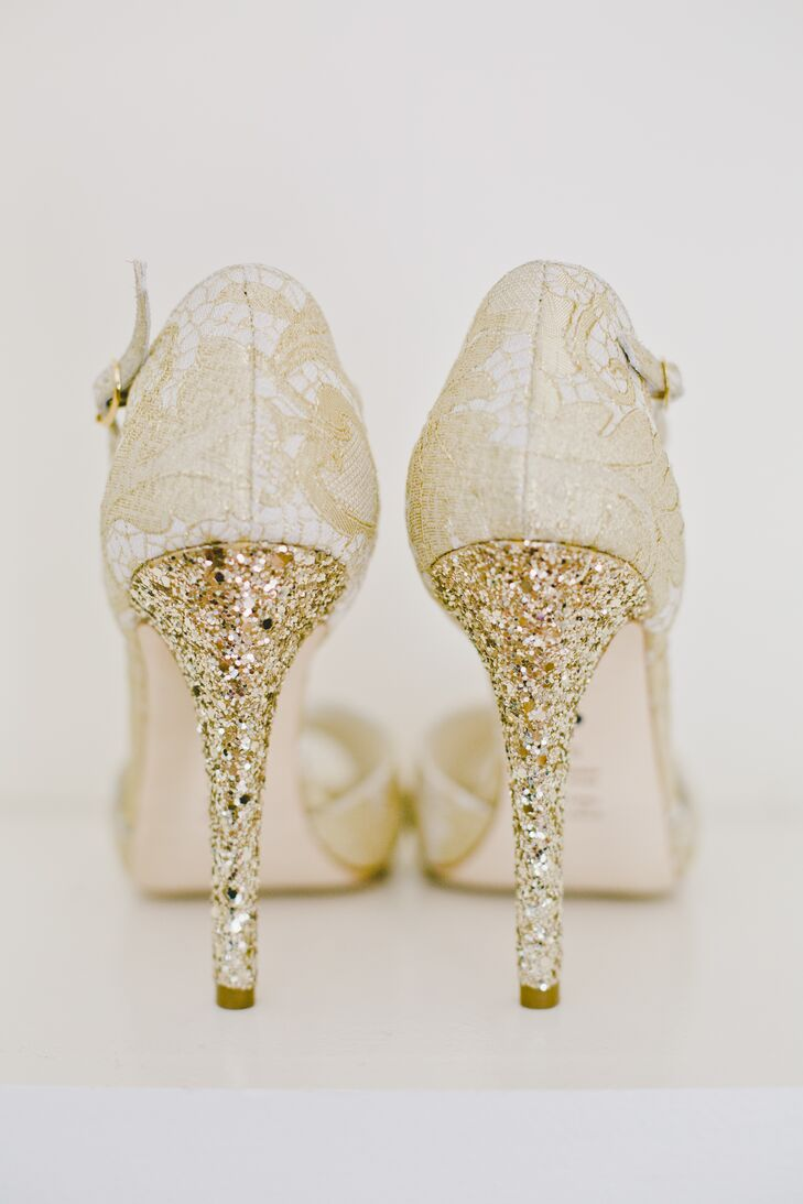 Among the day's elegant gold features, including jewelry and table chargers, Taylor's BHLDN shoes had lace detailing and sparkly gold heels.