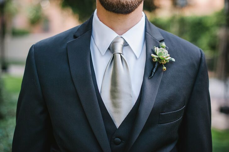 Cameron's groomsmen wore Black by Vera Wang suits with matching shiny silver ties.