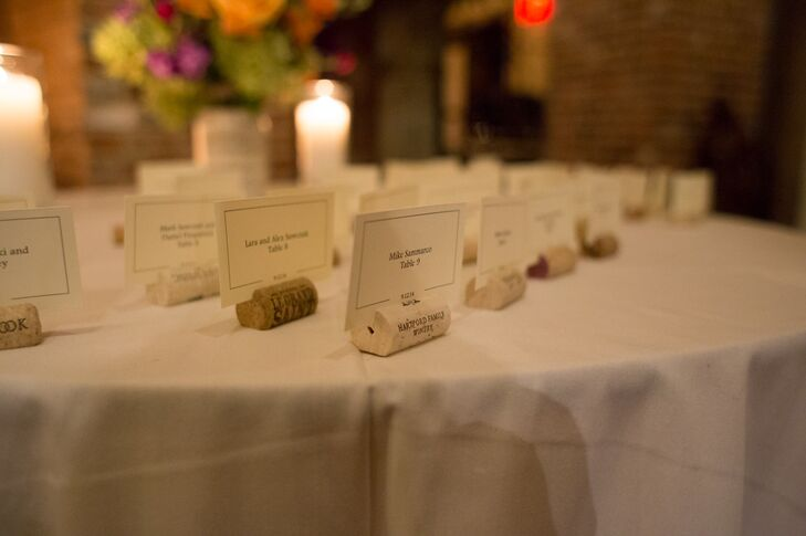 Details like wine cork escort cards and table number holders paid tribute to the wedding's vineyard setting.