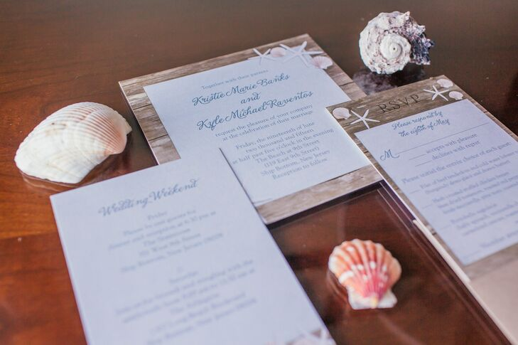 The Jersey Shore also influenced their invitation suite. Kristie and Kyle picked out neutral stationery that fit the beach vibe with a wood-inspired background, a few blush seashells and blue calligraphy.