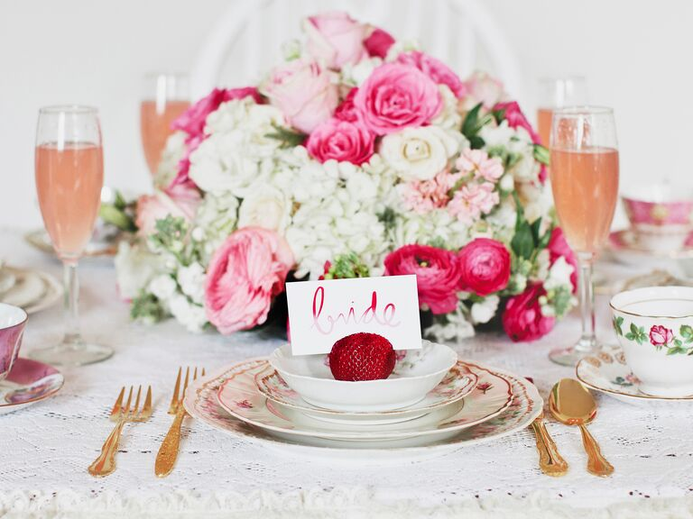 pink bridal shower table with bride place card