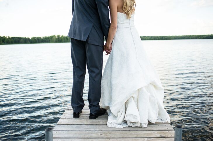 The bride wore a Justin Alexander dress while the groom wore a charcoal gray suit from Halberstadt's in Fargo, ND.