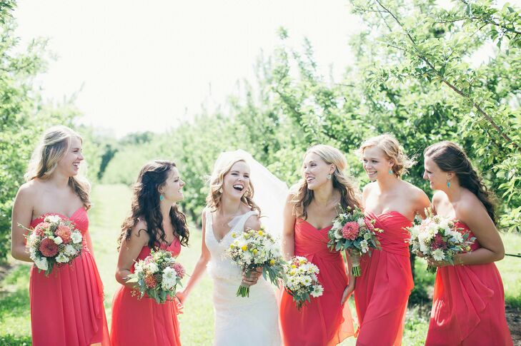 "Each of Taylor's bridesmaids chose a strapless dress from David's Bridal. ""They were free to pick out the style, but I wanted to choose the color,"" the bride says. ""They each pulled a few dresses and tried them on only to realize they all picked the same one!"""