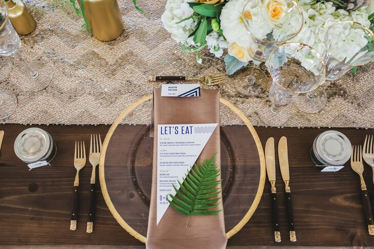 Since Ozzie loves glam and Bart likes neutrals, the couple found ways to use both aesthetics: Gold tableware contrasted nicely with organic wooden farm tables and earthy taupe napkins, while navy sequined linens added glitz to the alfresco space.