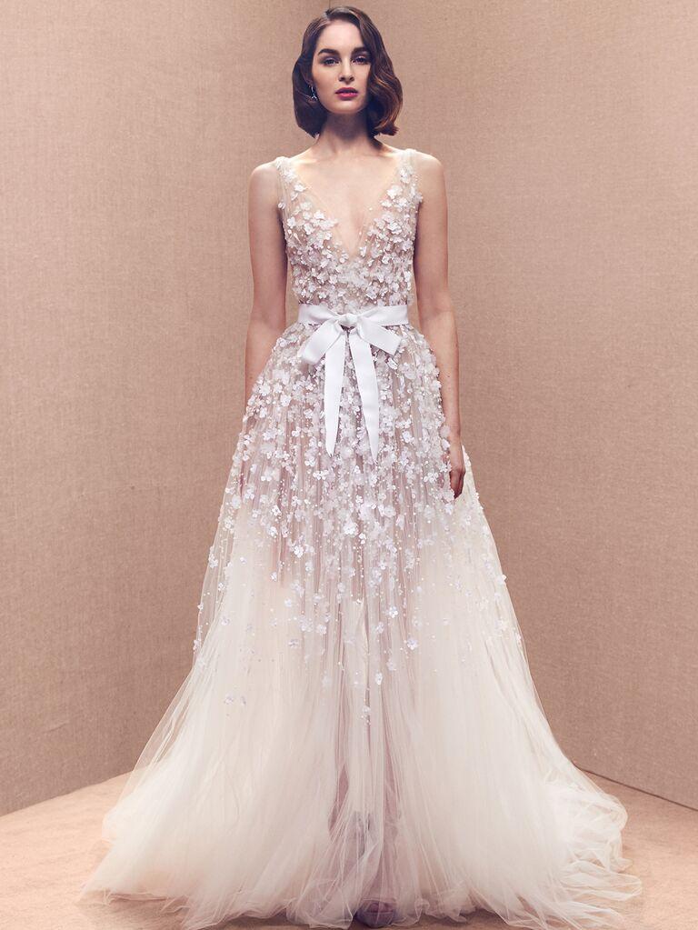 Oscar de la Renta Spring 2020 Bridal Collection floral-embellished wedding dress with tulle skirt and bow sash