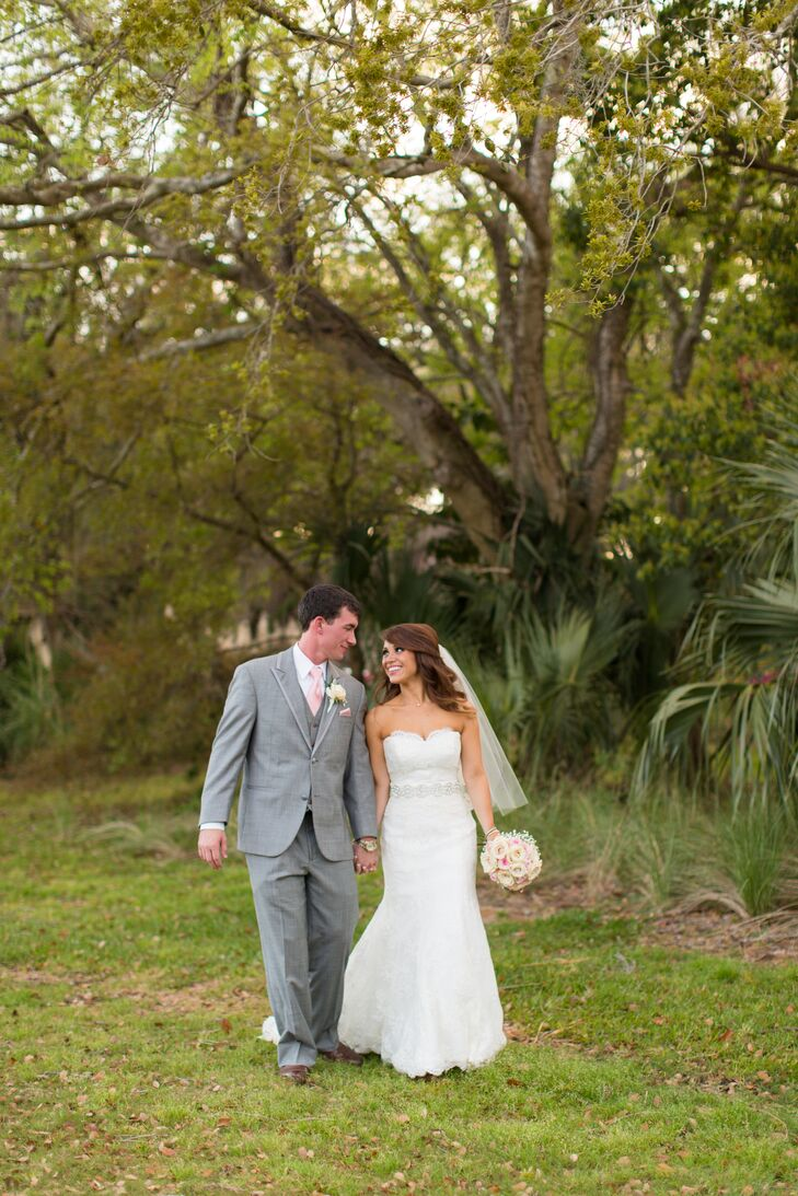 The bride wore a Monique Lhuillier wedding gown with an elegant sweetheart neckline and lace overlay.