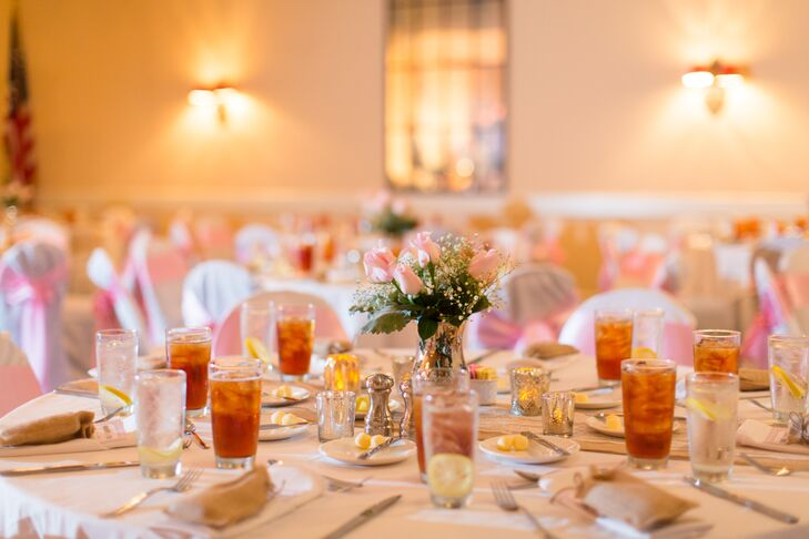 The classic centerpieces included pale pink roses, sahara roses and a hint of baby's breath.