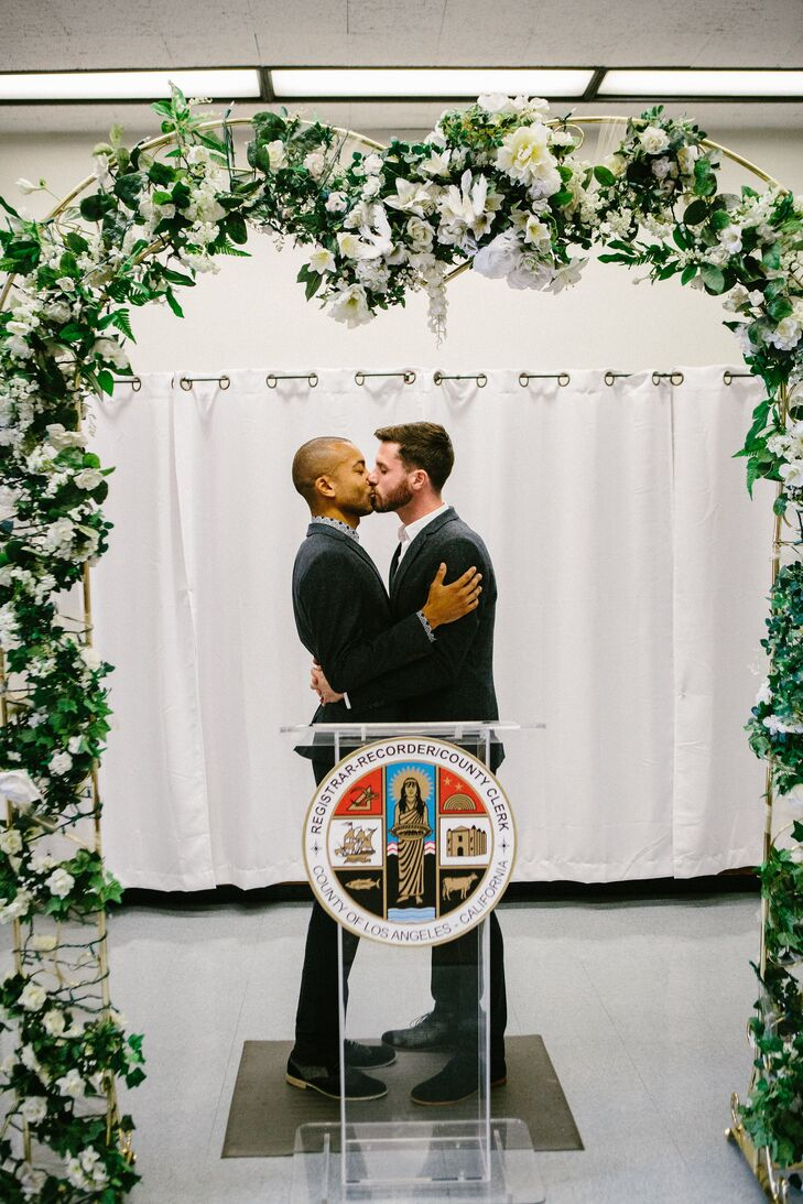 Jerrold and Drew shared their first kiss as a married couple underneath the garland archway at the altar.