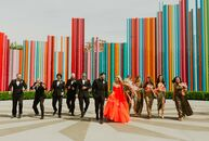 "For their colorful wedding, Erin May and Michael Bartlett chose a theme of ""Old Hollywood glam meets studio 54 in Vegas.""  The big day was inspired by"