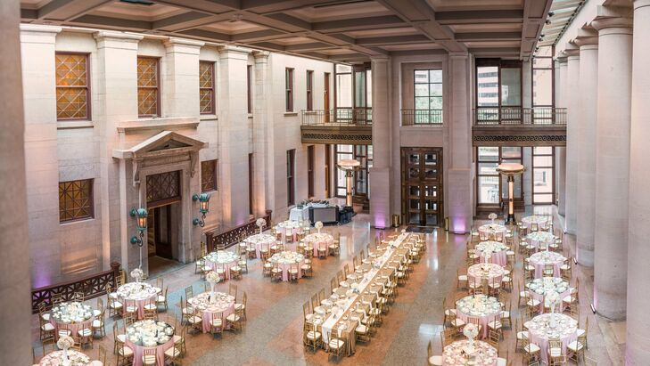 The reception featured a 32-seat, gold-glitz linen, communal-style head table in the center of the guest tables.